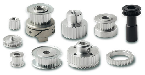 Toothed pulleys for belt drives